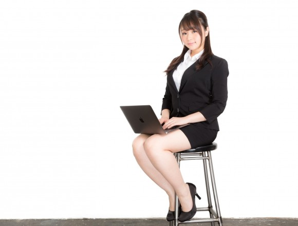 New graduate woman-sitting-in-a-chair-to-check-the-slide