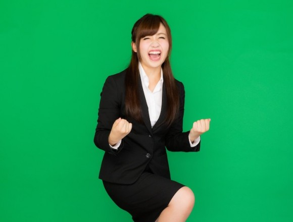 a-woman-in-a-suit-who-is-super-pleased-with-the-company-presentation